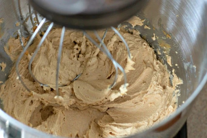 Whipping peanut butter, shortening, and sugar to make Chocolate Peanut Butter Cookies