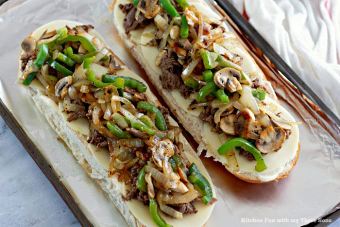 Filling Philly Cheesesteak Cheese Bread with meat and vegetables