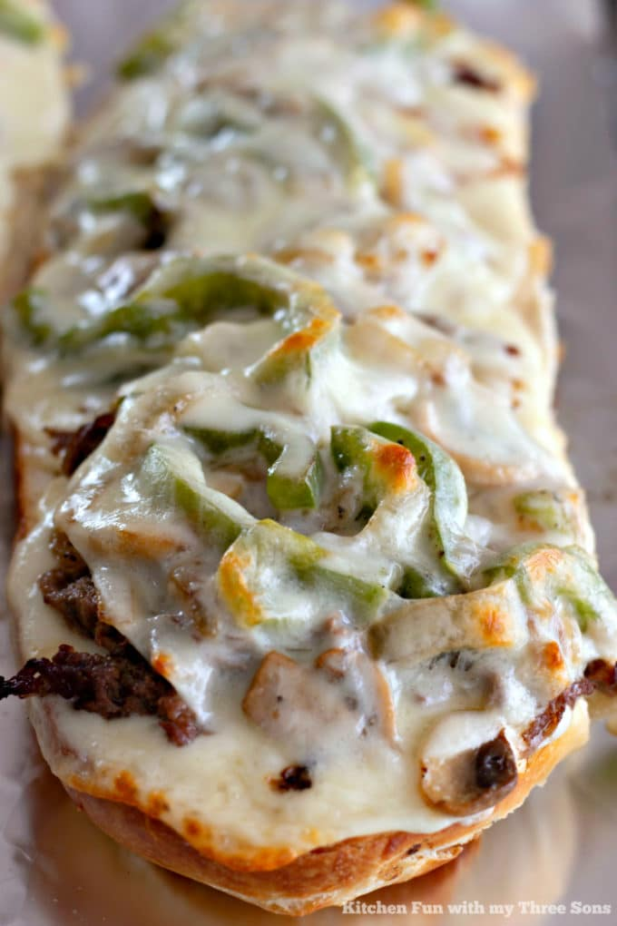 Philly Cheesesteak Cheese Bread on a foil-lined baking sheet