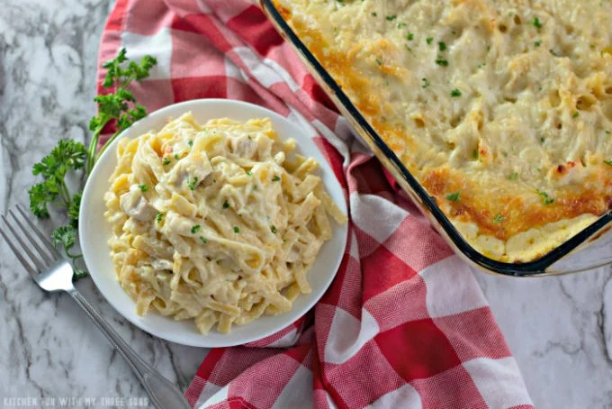 Easy Chicken Tetrazzini on a white plate with a red checked napkin