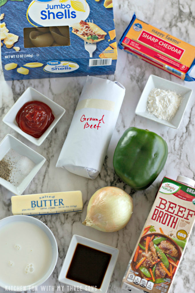 ingredients to make stuffed shells on a marble countertop
