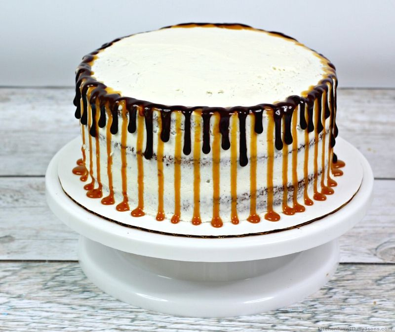 white cake with chocolate and caramel dripping on the sides
