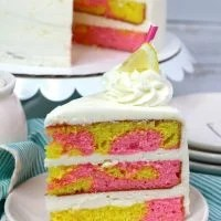yellow and pink cake on a white plate