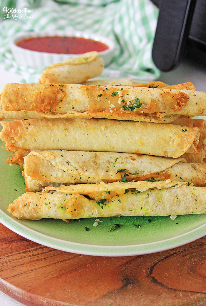 Air Fryer Taquitos with beans and cheese are delicious and so easy to make. You can make them ahead of time and quickly cook them when you're ready.