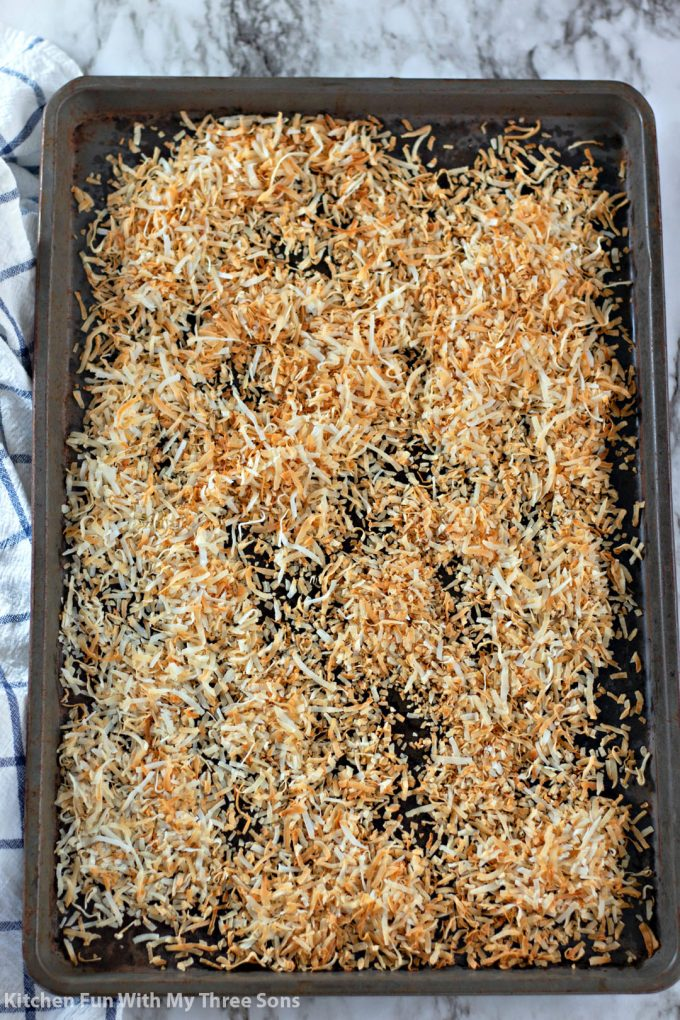 toasted coconut on a cookie sheet
