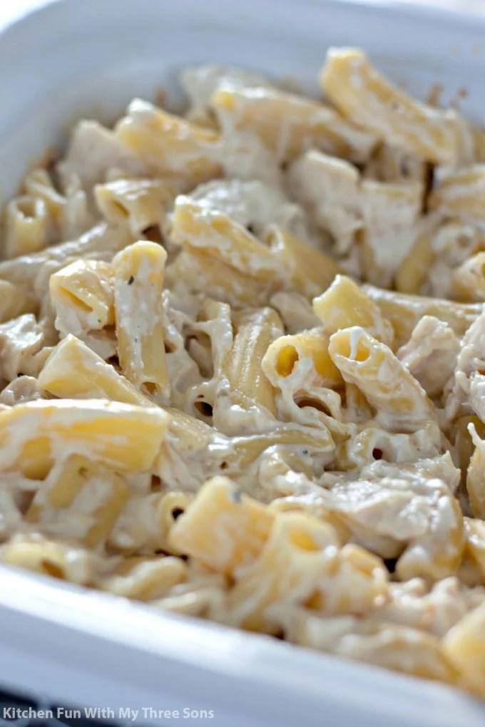 Slow Cooker Rigatoni Chicken Alfredo in a white crockpot
