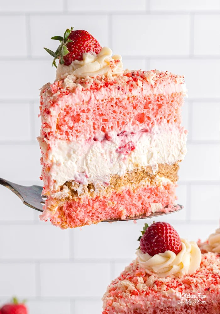 Strawberry Shortcake Cheesecake is quite honestly the best dessert ever made. It's got layers of fresh strawberry cake, white chocolate cheesecake with fresh strawberries and a wafer cookie crumble topping the homemade vanilla frosting.