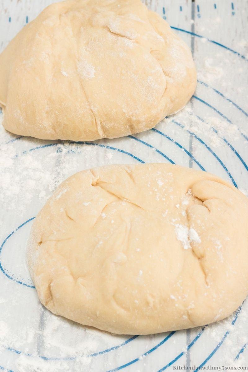 The bread dough cut in half.