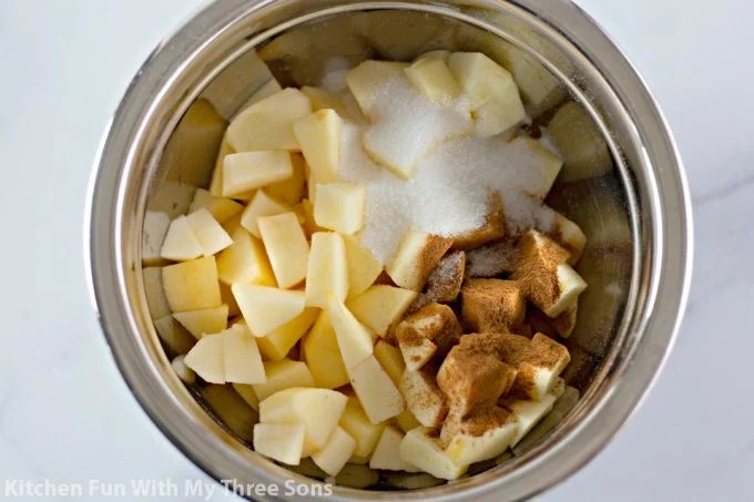 apples and cinnamon in a mixing bowl