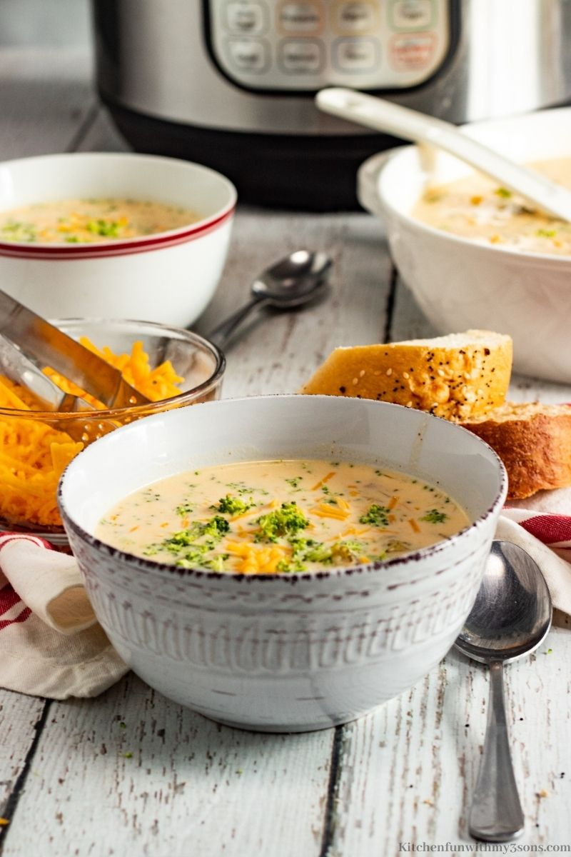 Best Ever Broccoli Cheese Soup Recipe served with sliced bread.
