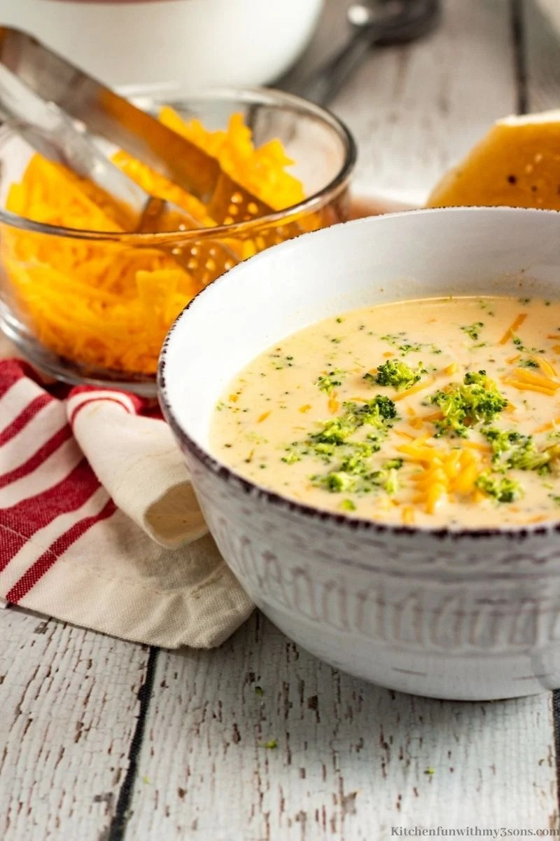 Best Ever Broccoli Cheese Soup Recipe topped with more broccoli and cheese.