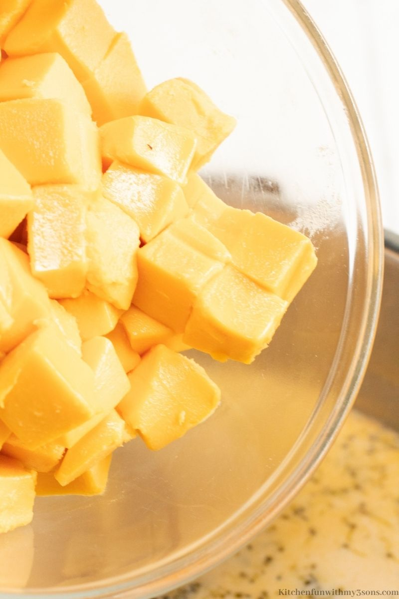Your diced cheese in a bowl, ready to put and melt into the soup.