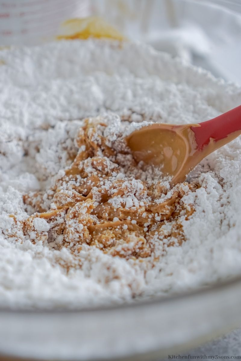 The powdered sugar added into the peanut butter mixture.