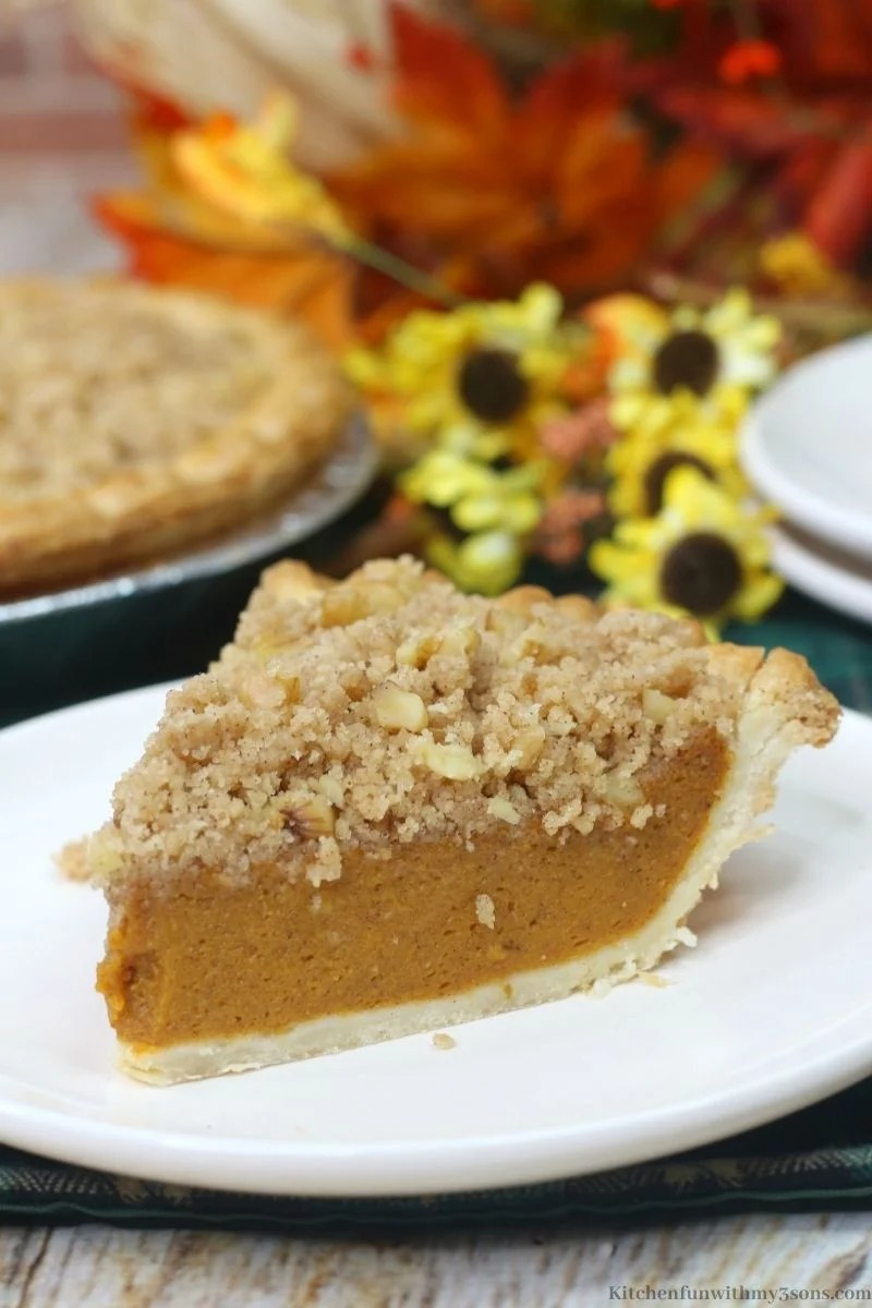 A close up of the Delicious Pumpkin Streusel Pie with the whole pie behind it.