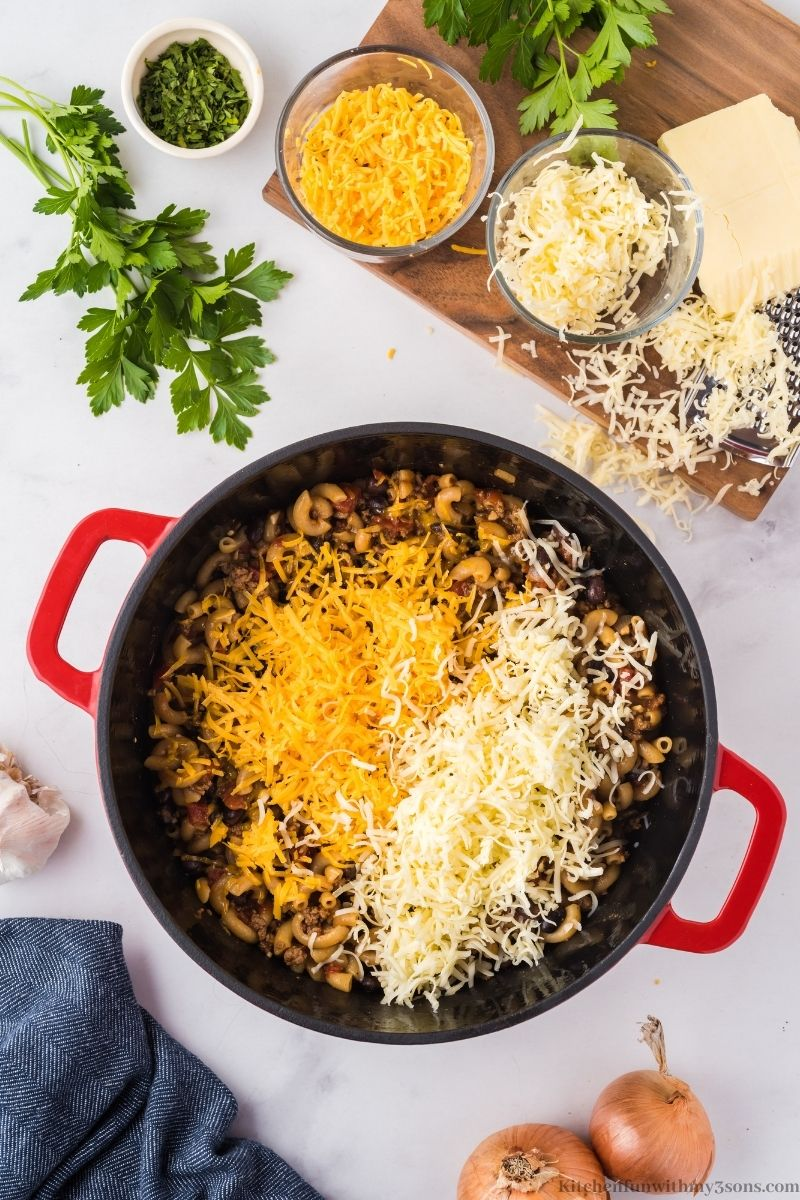 Adding the cheese on top of all your ingredients.