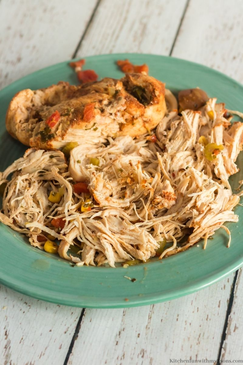 The chicken shredded on a plate.