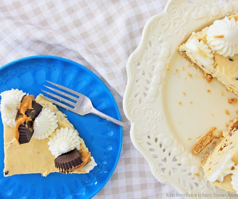 Peanut Butter Chocolate Chip Cheesecake Recipe on a serving plate with a fork.