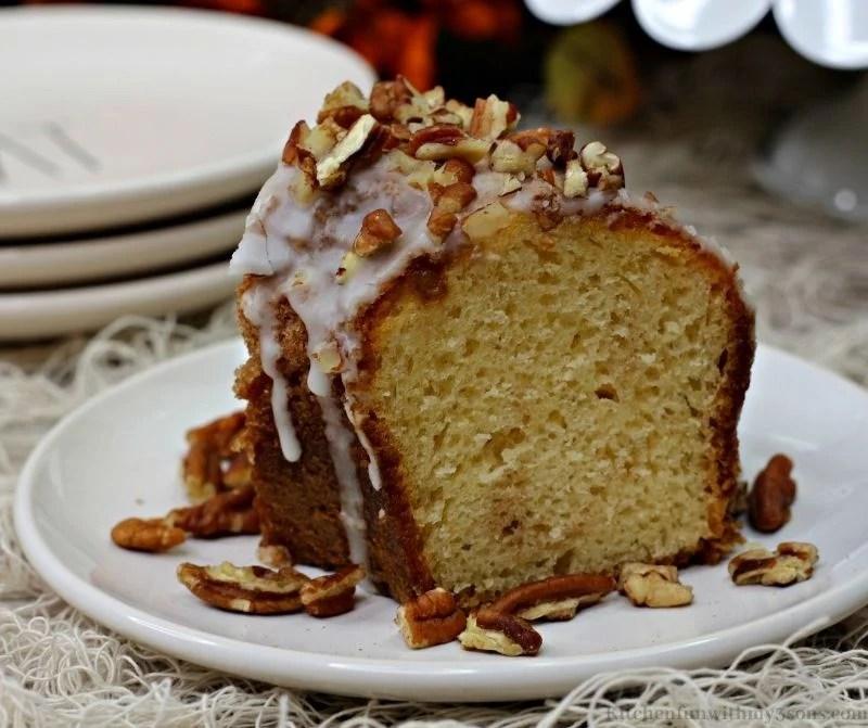 Pumpkin Bourbon Pecan Cake garnished with more pecans and glaze.