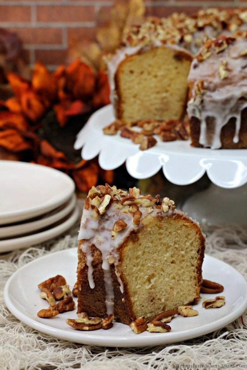 Pumpkin Bourbon Pecan Cake on a serving plate.