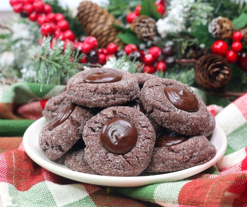 Chocolate Espresso Cookies on a serving plate with decorations behind it.