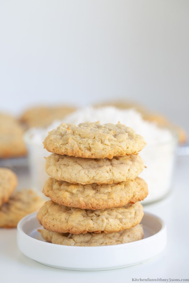 Easy Coconut Cookies stacked on top of each other.