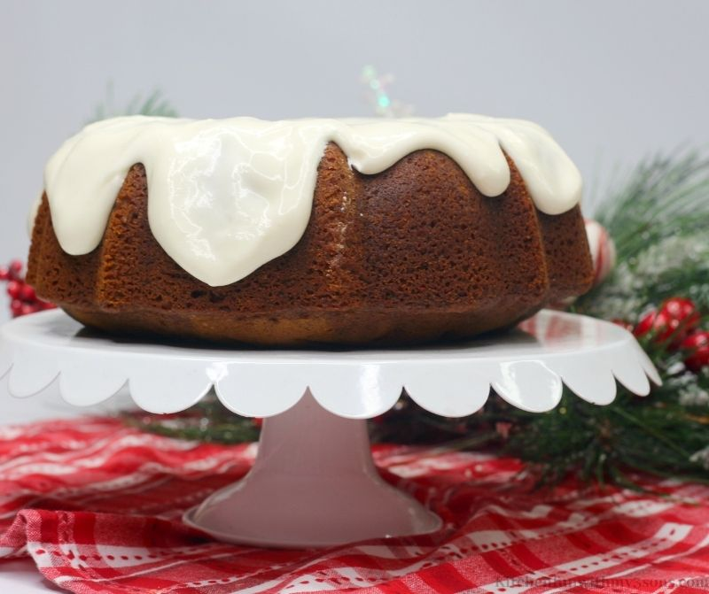 The Gingerbread Bundt Cake with branch directions behind it.