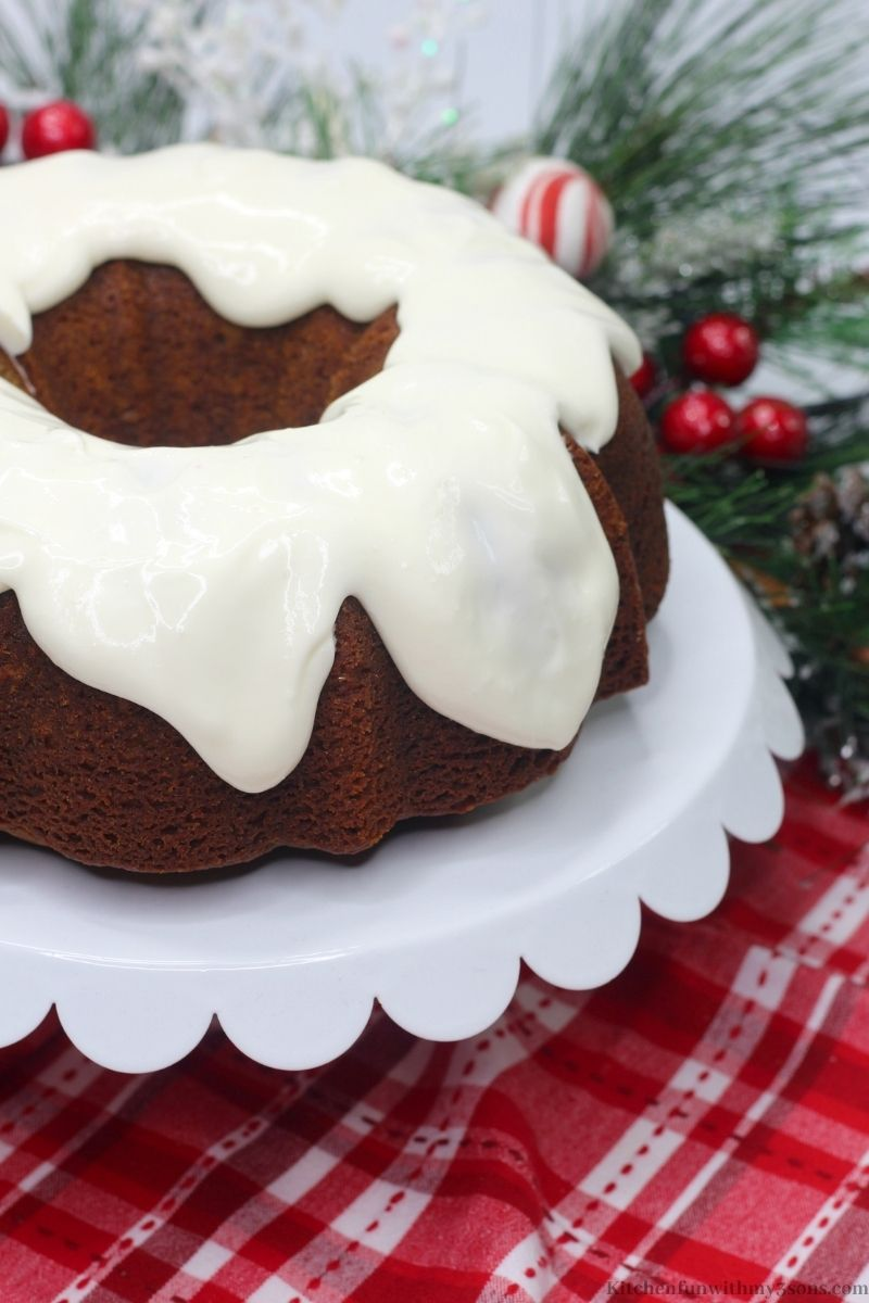 Gingerbread Bundt Cake on a serving platter stand.