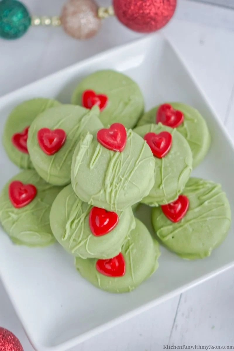 Grinch No Bake Cookies stacked on a serving platter.