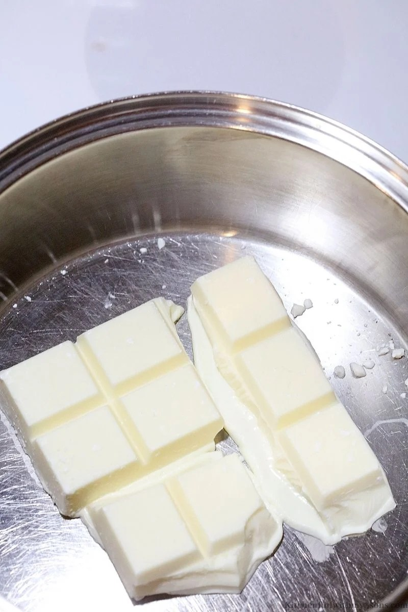Melting the white chocolate in the pot.