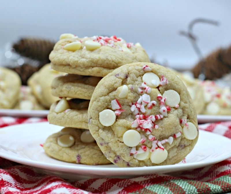 Peppermint White Chocolate Chip Cookies stacked on top of each other on a serving plate.
