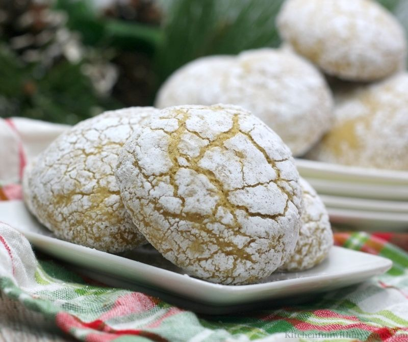 Pumpkin Spice Crinkle Cookies on a small white plate on a patterned cloth.