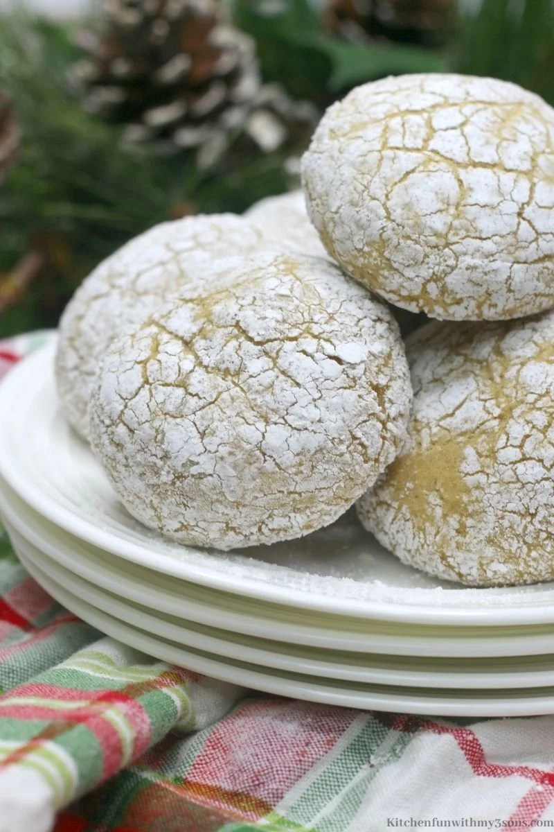 Pumpkin Spice Crinkle Cookies with tree decorations behind it with pine cones.