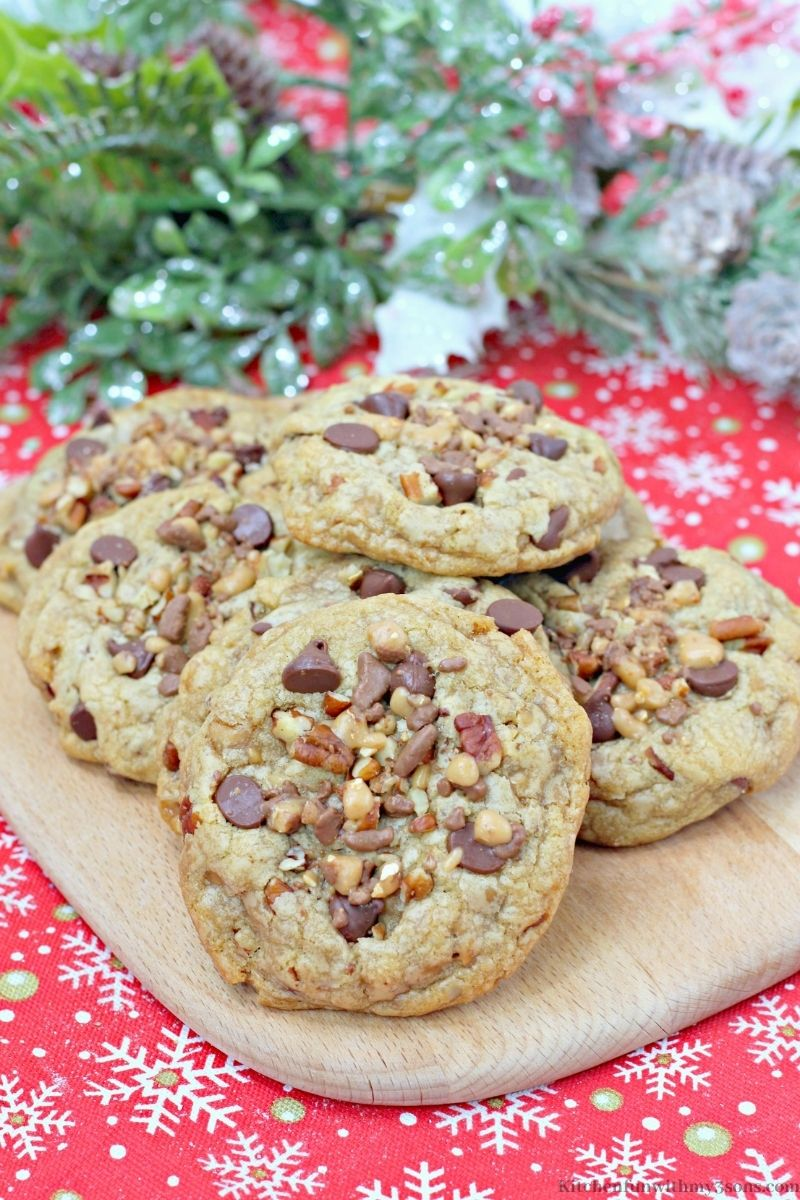 Chocolate Chip Pecan Toffee Cookies on a wooden board.
