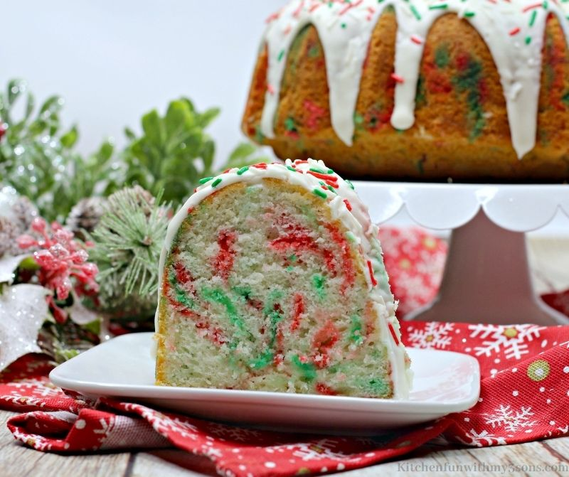 A slice of the Christmas Funfetti Bundt Cake on a serving plate.