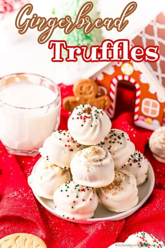Gingerbread Truffles with sprinkles, a glass of milk and a Gingerbread house