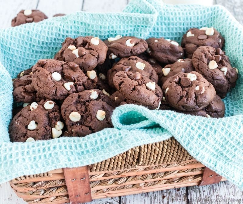 Triple Chocolate Cookies in a basket with a blue blanket.
