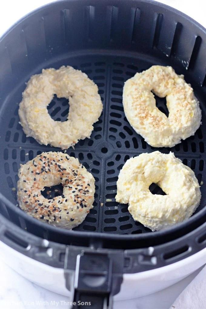 sprinkling toppings on bagels