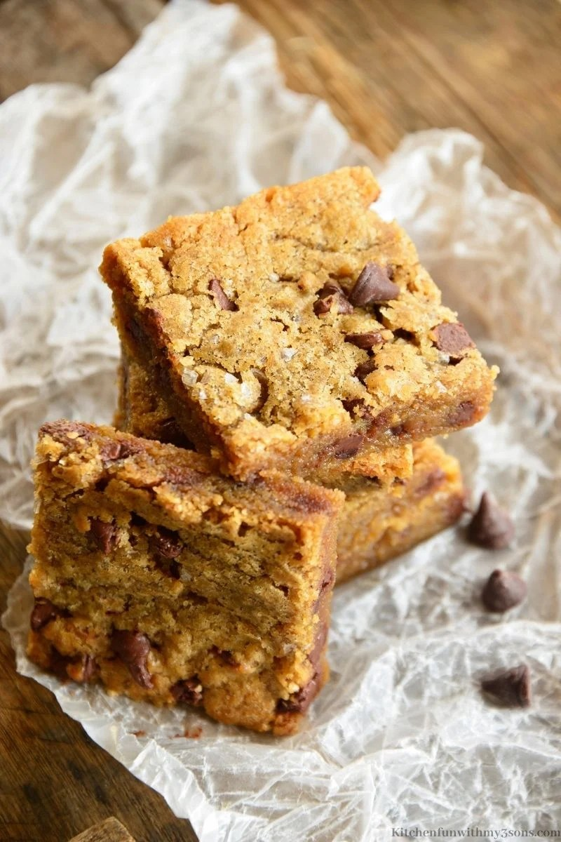 Brown Butter Blondies on parchment paper.