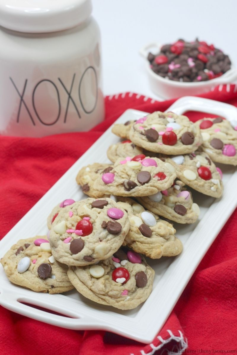 Valentine's Day Chocolate Chip Cookies with a cookie jar behind it.