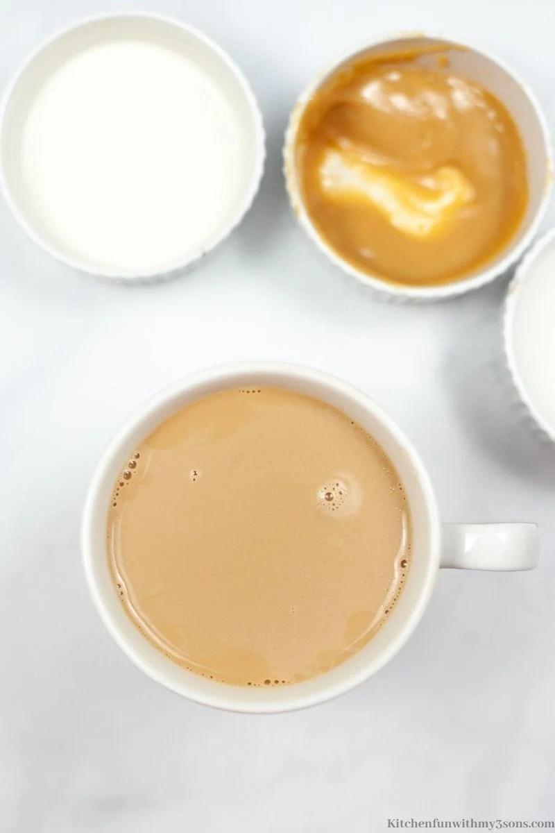Hot coffee poured into a mug.