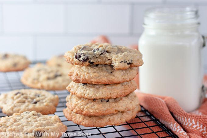 stacked Chewy Oatmeal Raisin Cookies with milk.