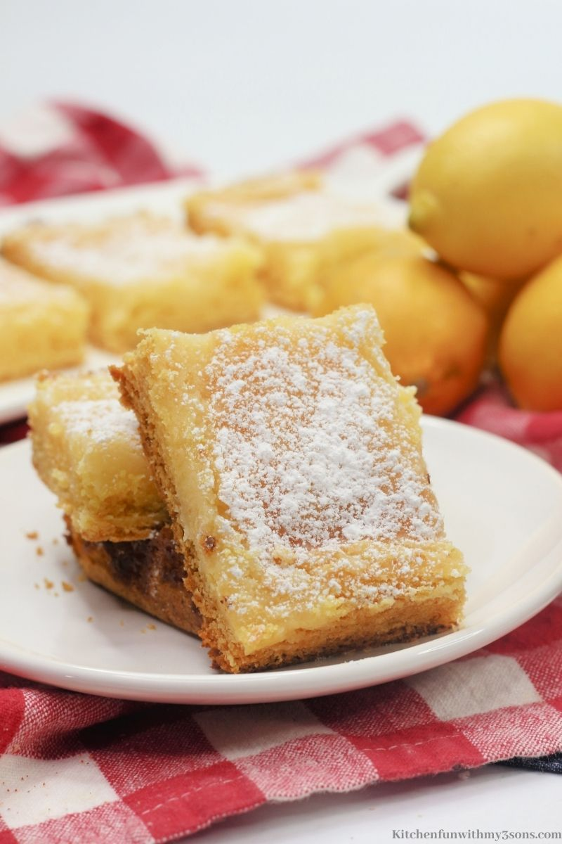 Lemon Bars on a red cloth.