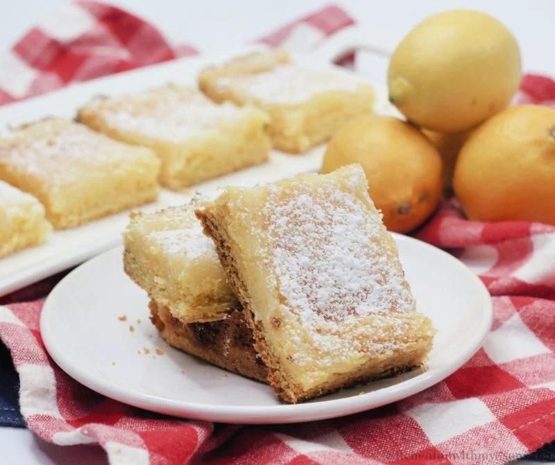 The lemon bars on a serving plate.