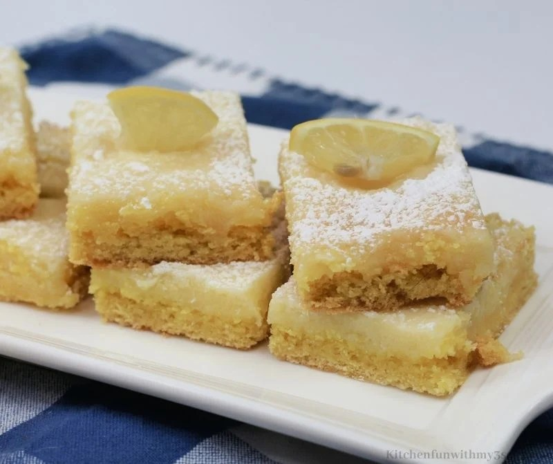 Lemon bars on a rectangle serving platter.