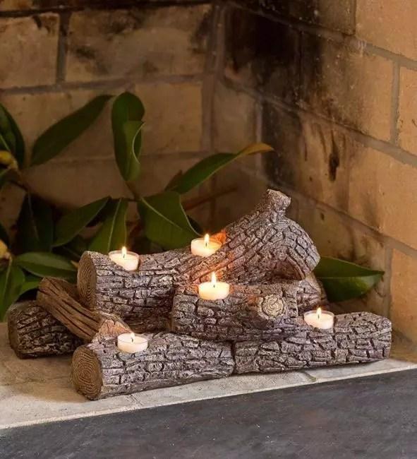 Рождество түнінде Санта үнемдеңіз: Каминдегі оттың орнына барда шамды қолданыңыз