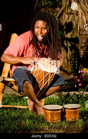 Black African Jamaican man, sitting amongst people ...