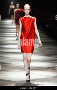 Lanvin Paris Ready to Wear Spring Summer Model wearing a short red     Photo  Hendrik Ballhausen  Lanvin Paris Ready to Wear Spring Summer Model  wearing short red satin dress and purple shoes