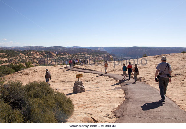 5a6a12fb228c3 tourists-on-sandal-trail-navajo-national-monument-arizona-bc56gn.jpg