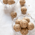 cinnamon protein balls in a glass jar and on parchment paper