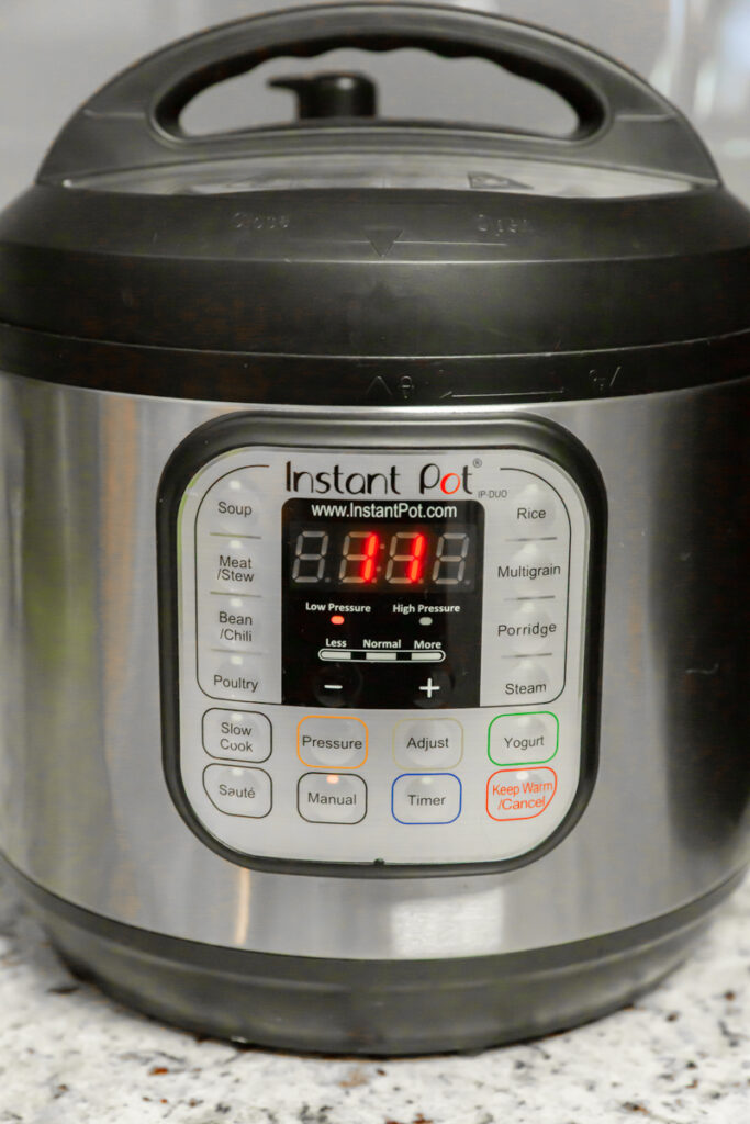 instant pot with timer set to 11 minutes